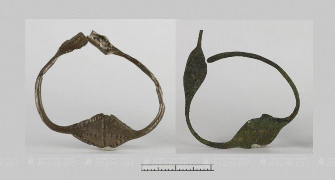 Характерным женским украшением новгородских словен был ромбощитковый вариант височных колец